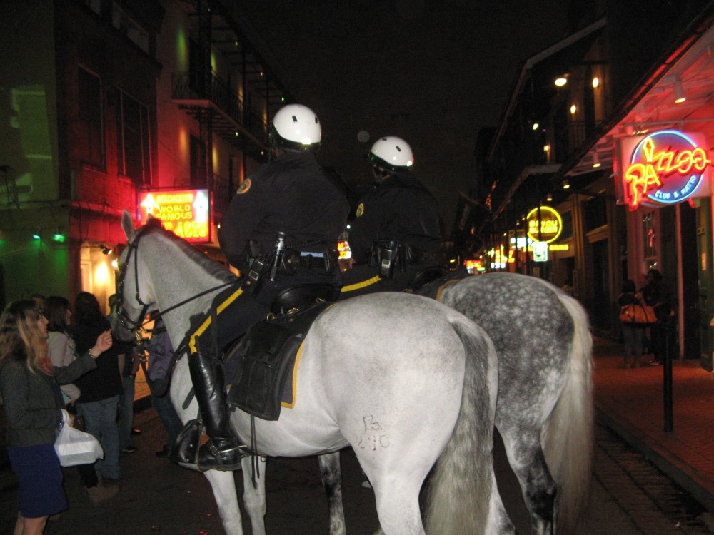 Horses and officers of the New Orleans Police Department patrol Bourbon Street. PHOTO BY PETER MCDERMOTT