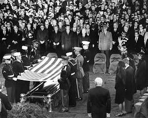 "AR8255-3K 25 November 1963 Burial and folding of the flag ceremony for President John F. Kennedy. Photograph includes: (right side, front to back) Jacqueline Kennedy, Robert F. Kennedy, Eunice Shriver, Patricia Lawford, Jean Smith, Super of the Arlington National Cemetary Jack Meltzer, (front row middle to right) President of West Germany Heinrich Luebbe, General Charles de Gaulle of France, Emperor of Ethiopia Haile Selassie, President of the Phillipines Diosdado Macapagal, and mourners. Gravesite, Arlington National Cemetary, Washington, D.C. Please credit: ""Abbie Rowe, National Parks Service/John F. Kennedy Presidential Library and Museum, Boston"""